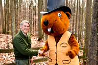 Art Shomo, of the West Virginia DNR shakes hands with the French Creek Freddie costumed mascot
