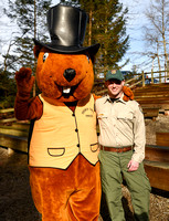 Tyler Evans, wildlife biologist at the Wildlife Center poses with French Creek Freddie costumed mascot